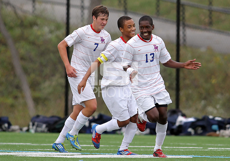 HYATTSVILLE, MD - OCTOBER 26, 2012:  Christian Cooke (7), Julian Dove (17) and Arion Sobers-Assue (13) of DeMatha Catholic High School after Arion Sobers-Assue (13) had scored the first goal against St. Albans during a match at Heurich Field in Hyattsville, MD. on October 26. DeMatha won 2-0.