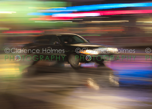 Motion blurred abstraction of limousine rushing through Times Square
