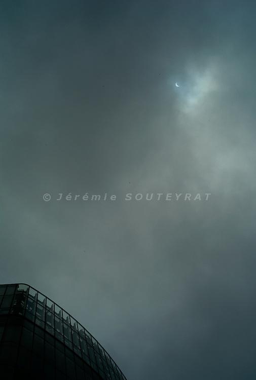Shibuya, Tokyo, Japan - 22nd of July 2009 - Partial solar eclipse (75%).