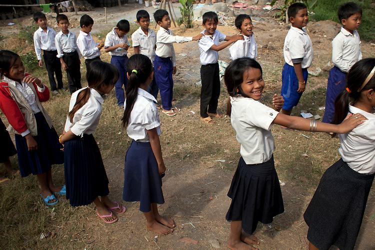 School children line up after recess in a village school near Battambang, Cambodia. <br /> <br /> Photos &copy; Dennis Drenner 2013.