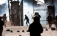 Paramilitary police and  stone throwing youth clash following Friday prayer at the Jamia Masjid.  Srinagar, Kashmir, India.  Fredrik Naumann/Felix Features