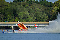 Frame 2: #37 Stacy Funk rolls over after contact with #31 Dan Schwartz (red and White boat with it's cowling in the air). Funk rolled completely over while it is speculated that Schwartz was knocked unconscious in the accident and accelerated across the river and crashed onto the golf course. In the later images of this series Schwartz can be seen emerging from behind Funk's boat. (SST-120 class)