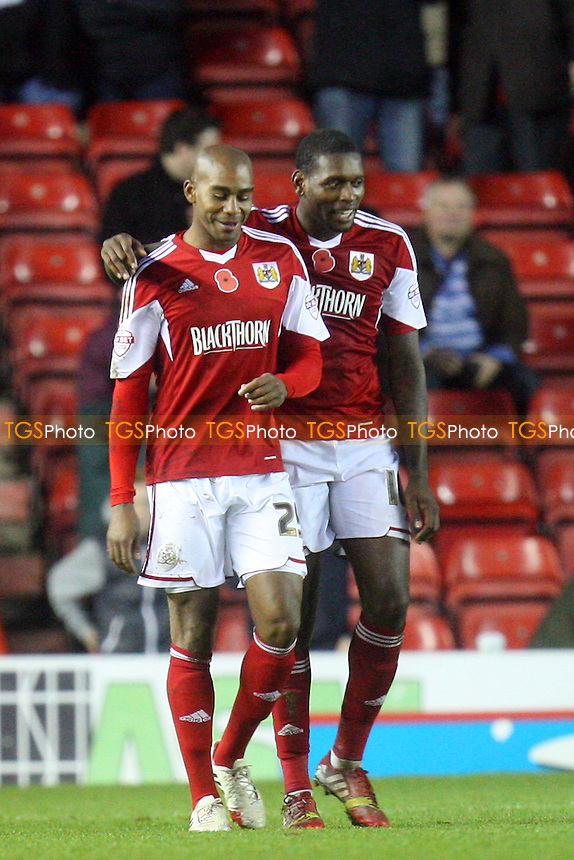 Marvin Elliott of Bristol City (25) is congratulated after scoring the second Robins goal -  Bristol City vs Dagenham and Redbridge at the Ashton Gate Stadium - 09/11/13 - MANDATORY CREDIT: Dave Simpson/TGSPHOTO - Self billing applies where appropriate - 0845 094 6026 - contact@tgsphoto.co.uk - NO UNPAID USE