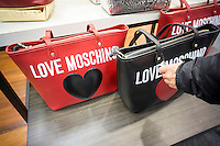 Moschino designer handbags on sale at the Saks Fifth Avenue Off Fifth discount spin-off brand in New York, seen on Sunday, March 6, 2016. The 47,000 square foot store, selling discounted merchandise also contains a Gilt Groupe shop which will offer weekly flash sales. Hudson's Bay Co., the owner of Saks, recently purchased the Gilt Groupe.  (© Richard B. Levine)