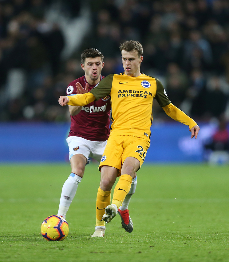 Brighton & Hove Albion's Solly March and West Ham United's Aaron Cresswell<br /> <br /> Photographer Rob Newell/CameraSport<br /> <br /> The Premier League - West Ham United v Brighton and Hove Albion - Wednesday 2nd January 2019 - London Stadium - London<br /> <br /> World Copyright © 2019 CameraSport. All rights reserved. 43 Linden Ave. Countesthorpe. Leicester. England. LE8 5PG - Tel: +44 (0) 116 277 4147 - admin@camerasport.com - www.camerasport.com