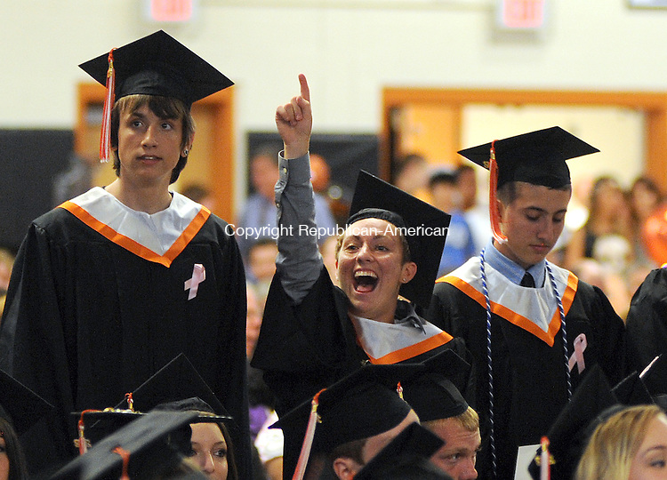 WATERTOWN, CT-14 JUNE 2012--061512JS10-Watertown High School graduate Jessica Spezzano, center, yells to someone in the stands after she received her diploma during graduation ceremonies Friday at Watertown High School. . Jim Shannon Republican-American