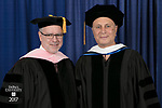 Ronald Caltabiano, dean of the School of Music, and commencement speaker and honorary degree recipient John Corigliano, a Grammy Award-winning American composer. DePaul University School of Music and The Theatre School held its commencement ceremony, Saturday, June 10, 2017, during the DePaul University School of Music and The Theatre School commencement ceremony at the Rosemont Theatre in Rosemont, IL. (DePaul University/Jeff Carrion)
