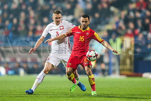 March 26th 2017, Podgorica City Stadium,  Montenegro; World Cup 2018 Internationl football qualification, Montenegro versus Poland; Artur Jedrzejczyk (POL) shielded from the ball by Damir Kojasevic (MNE),