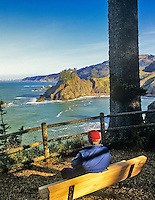 Man on bench at Arch Rock viewpoint. Oregon