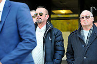Pictured: family members stand as DCI Darren George (not in frame) of South Wales police reads a statement on behalf of the family of John 'Jack' Williams, outside Swansea Crown Court, in Wales, UK. Thursday 01 November 2018<br /> Re: Jonathan Donne, a convicted killer who murdered 67 year old John 'Jack' Williams after robbing him in his own home has been jailed for life by Swansea Crown Court.<br /> Donne, 42, from Swansea, was found guilty of the robbery and murder.<br /> Mr Williams was tied up and battered in the living room of his Swansea home in March 2018 because Donne thought he had a large quantity of drugs and money.<br /> He was told he must serve at least 31 years before he can be released from prison.<br /> He was also given a 15 year sentence for robbery, which will be served concurrently.<br /> Donne went to Mr Williams's house because he needed money where he hit and tied Mr Williams up, but insisted he was alive when he left.<br /> Mr Williams suffered serious brain and head injuries in the attack.<br /> The victim had been growing and selling cannabis and Donne thought he would have drugs and cash he could steal.