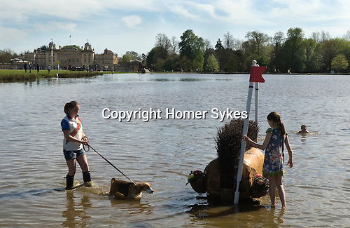 Badminton Horse Trials Gloucestershire UK. Children play in The Lake at the end of the horse trials.