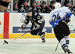 SIOUX FALLS, SD - APRIL 16:  Tony Calderone #17 from the Sioux Falls Stampede pushes the puck as Eric Schurhamer #24 from the Lincoln Stars defends in the first period of their 2013 USHL playoff game Tuesday night at the Sioux Falls Arena. (Photo by Dave Eggen/Inertia)