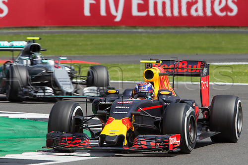 10.07.2016. Silverstone, England. Formula One British Grand Prix, race day.  Red Bull Racing driver Max Verstappen is chased down by Mercedes AMG Petronas Formula One Team driver Nico Rosberg.