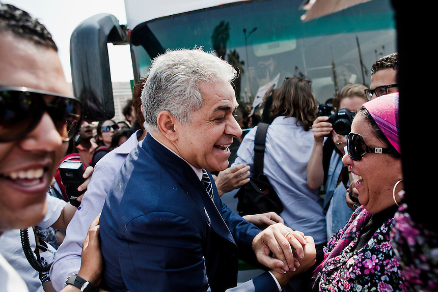 Socialist presidential candidate Hamdeen Sabahi greets a campaign supporter while on the campaign trail in central Cairo, Egypt, May 20, 2012. Photo: ED GILES.