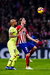 Filipe Luis of Atletico de Madrid (R) in action against Arturo Vidal of FC Barcelona (L) during the La Liga 2018-19 match between Atletico Madrid and FC Barcelona at Wanda Metropolitano on November 24 2018 in Madrid, Spain. Photo by Diego Souto / Power Sport Images