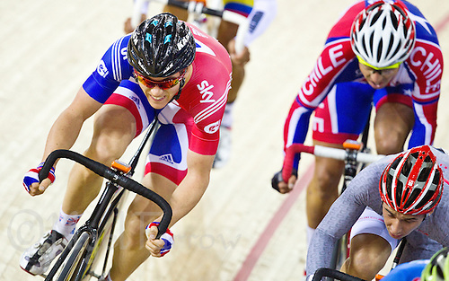 17 FEB 2012 - LONDON, GBR - Great Britain's Ben Swift (GBR) (in blue and red) battles to keep near the head of the pack during the Men's Omnium Elimination Race at the UCI Track Cycling World Cup, and London Prepares test event for the 2012 Olympic Games, in the Olympic Park Velodrome in Stratford, London, Great Britain .(PHOTO (C) 2012 NIGEL FARROW)