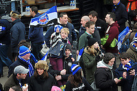 A young Bath Rugby fan in the crowd waves a flag in support. LV= Cup match, between Bath Rugby and the Ospreys on February 7, 2015 at the Recreation Ground in Bath, England. Photo by: Patrick Khachfe / Onside Images
