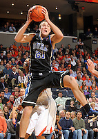 Feb. 16, 2011; Charlottesville, VA, USA; Duke Blue Devils forward Miles Plumlee (21) grabs a rebound in front of Virginia Cavaliers forward Akil Mitchell (25) during the first half of the game at the John Paul Jones Arena. Credit Image: © Andrew Shurtleff