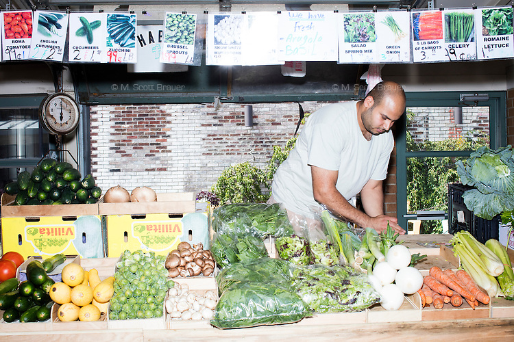 A fruit and vegetable seller works in Cleveland's West Side Market in Cleveland, Ohio.