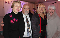 NWA Democrat-Gazette/CARIN SCHOPPMEYER Lynne Walton (from left), Alan and Corrina Dranow and Sandy Edwards gather Dec. 6 at the Peel Mansion  and Heritage Gardens in Bentonville for Christmas at the Mansion.