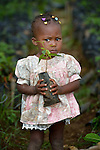 Shouna Adolf, 2, holds a seedling in a plant nursery in Despagne, an isolated village in southern Haiti where the Lutheran World Federation has been working with residents to improve their quality of life. The LWF-sponsored nursery helps residents combat their country's rampant deforestation.