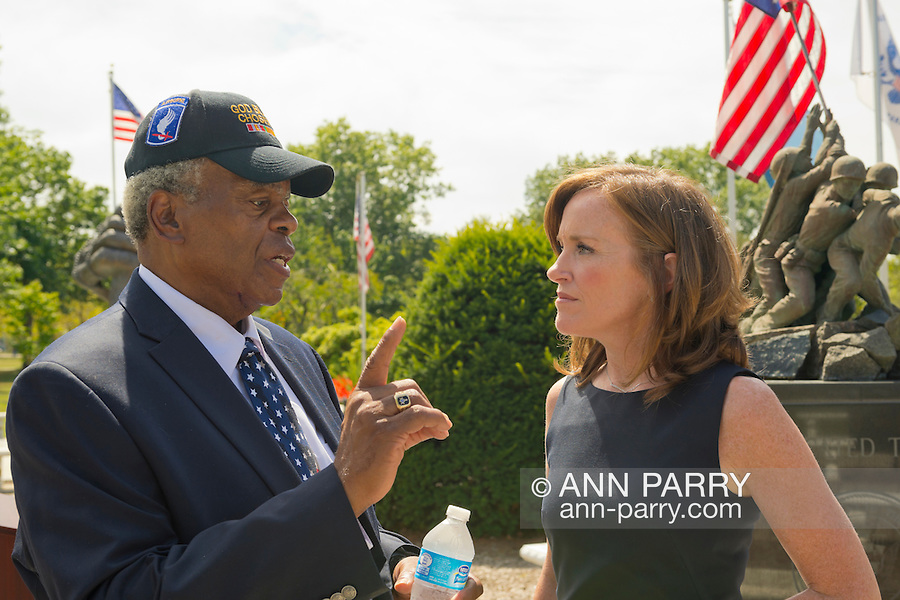 East Meadow, New York, U.S. - September 3, 2014 - KATHLEEN RICE, Democratic congressional candidate (NY-04), is speaking with one of the members of her campaign's new Veterans Advisory Committee, JEREMIAH E. BRYANT, of Rockville Centre, U.S. Army, Vietnam War Veteran. Rice announced formation of the committee and released a whitepaper on veterans policy, at Veterans Memorial at Eisenhower Park. Rice is in her third term as Nassau County District Attorney, Long Island.