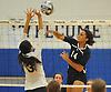 Massapequa No. 14 Kole Pollock, right, makes a spike attempt during a Nassau County varsity girls' volleyball match against host Plainview JFK High School on Monday, October 19, 2015. Massapequa won 25-16, 25-8, 25-13.<br /> <br /> James Escher