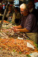 Customers being served at fish stalls in the Rialto Market - Venice Italy