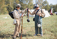NWA Democrat-Gazette/CHARLIE KAIJO Colt Bewley (left) helps his brother Tom Bewley (right) put on gear, Friday, October 4, 2019 at a field north of Pea Ridge along the Missouri border in Pea Ridge.<br /> <br /> Members of the Trans Mississippi Brigade set up camp for visitors to see life as it was in the 1860s in a battle camp. The camp will be open from 9 a.m. to 9 p.m. Friday through Sunday. There will be two battle reenactments — one at 1 p.m. Saturday and the other at 1 p.m. Sunday. The battle on Saturday will reenact the Battle of Elkhorn that was won by the Confederates. The battle on Sunday will be Welfley's Knoll and the Union will win.