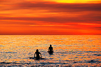 May 15, 2014 - San Diego, California, USA - Surfers wait for a wave at La Jolla Shores Beach as smoke from recent  San Diego County wildfires fills the air creating an orange sunset.  California has had record heat for for the second time in May.   (Photo Credit: © K.C. ALFRED/ZUMA PRESS)