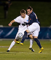 Martin Murphy (8) of North Carolina fights for the ball with Ryan Zinkhan (21) of Virginia during the game at the Maryland SoccerPlex in Germantown, MD. North Carolina defeated Virginia on penalty kicks after playing to a 0-0 tie in regulation time.  With the win the Tarheels advanced to the finals of the ACC men's soccer tournament.