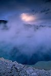 Steam rising off Sapphire Pool on a stormy evening, Biscuit Basin, Yellowstone National Park, WYOMING