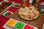 Gingerbread men and sugar cookies  waiting ro be decorated with colorful icing, M&Ms and sprinkles