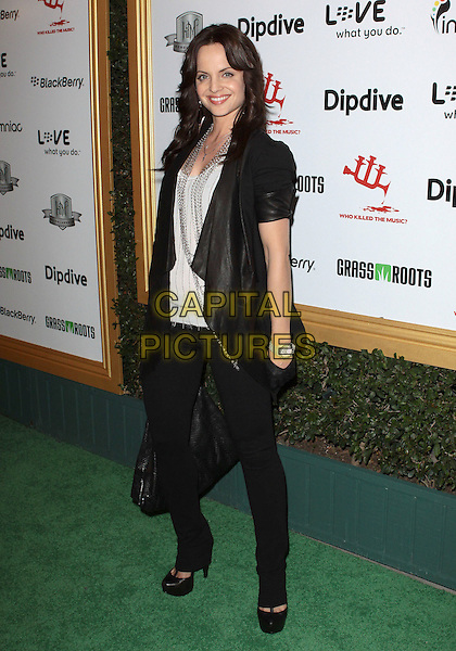 MENA SUVARI.The First Annual Data Awards held at The Hollywood Palladium in Hollywood, California, USA..January 29th 2010.full length black leather short sleeved waterfall front jacket bag gloves jeans t-bar shoes platform grey gray top necklace silver chains chain clutch trousers jeans denim .CAP/ADM/TC.©T.Conrad/Admedia/Capital Pictures