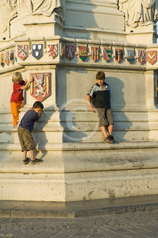Belgium, Ghent, Children playing at base of statue