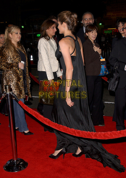 "ANGELINA JOLIE.Attends The Warner Brothers' World Premiere of ""Alexander"" held at The Graumann's Chinese Theatre in Hollywood, California, USA, November 16th 2004.full length long black dress back behind.Ref: DVS.www.capitalpictures.com.sales@capitalpictures.com.©Debbie VanStory/Capital Pictures"