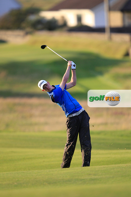 Evan Farrell (Ardee) on the 18th fairway during Round 1 of the South of Ireland Amateur Open Championship at LaHinch Golf Club on Wednesday 22nd July 2015.<br /> Picture:  Golffile | Thos Caffrey