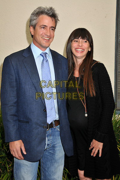"""DERMOT MULRONEY & THARITA CATULLE.""""My Life in Ruins"""" Los Angeles Special Screening held at 20th Century Fox Studios, Century City, CA, USA..May 29th, 2009.half length blue suit jacket jeans denim black dress couple pregnant .CAP/ADM/BP.©Byron Purvis/AdMedia/Capital Pictures."""