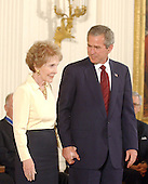 United States President George W. Bush honors former First Lady Nancy Reagan with the Presidential Medal of Freedom during a ceremony in the East Room of the White House in Washington, DC on 9 July, 2002.<br /> Credit: Ron Sachs / CNP