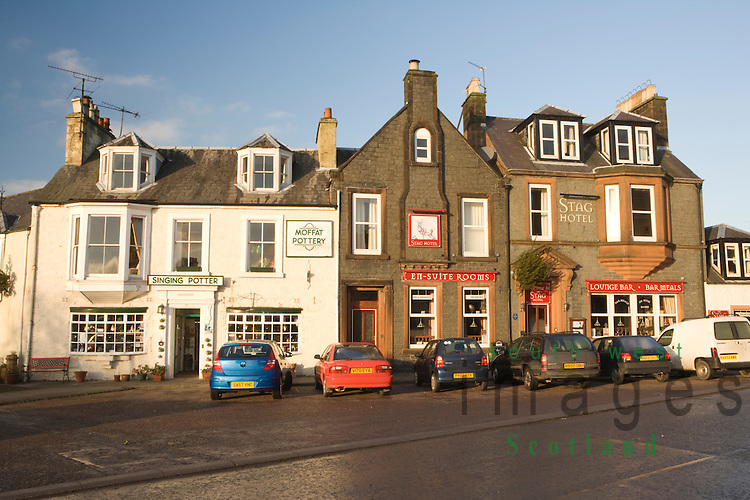 Moffat town centre the Sing Potter at the Moffat Pottery and the Stag Hotel on the High Street Scotland UK