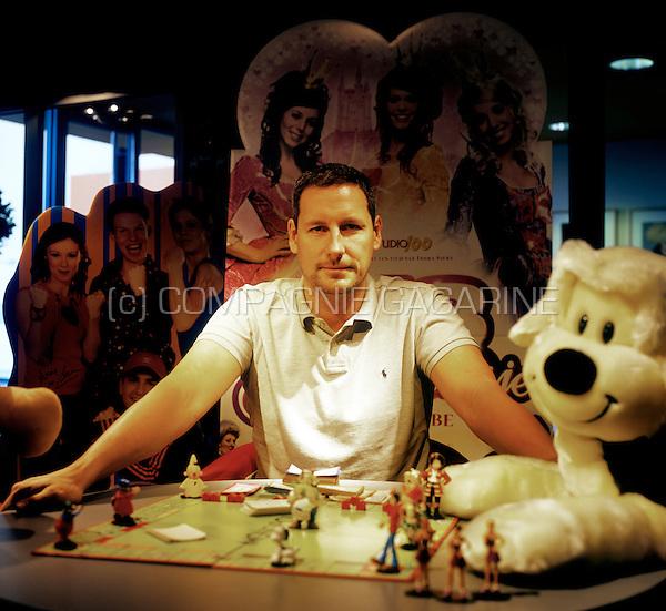 Studio 100 manager Gert Verhulst playing the monopoly game in his headquarters in Schelle (Belgium, 26/03/2007)