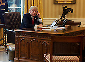 US President Donald Trump speaks with the King of Saudi Arabia, Salman bin Abd al-Aziz Al Saud in the Oval Office of the White House, January 29, 2017, Washington, DC. <br /> Credit: Aude Guerrucci / Pool via CNP