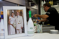 A framed wedding portrait of Prince Albert II and Princess Charlene on the bar of a cafe in le Nouveau Marché de la Condamine, Monaco, 18 October 2013. Across the Principality, many restaurants, shops and other small businesses display framed portaits of the Sovereign Prince.