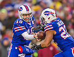 14 December 2014: Buffalo Bills quarterback Kyle Orton hands off to running back Fred Jackson in the third quarter against the Green Bay Packers at Ralph Wilson Stadium in Orchard Park, NY. The Bills defeated the Packers 21-13, snapping the Packers' 5-game winning streak and keeping the Bills' 2014 playoff hopes alive. Mandatory Credit: Ed Wolfstein Photo *** RAW (NEF) Image File Available ***
