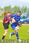 Mark Egan Mastergeeha puts Killarney Athletic striker Ronan Murphy under pressure during their game in Mastergeeha on Saturday