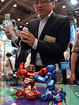 June 14, 2012, Tokyo, Japan - A visitor uses a wireless transmitter to have Takara Tomys boxing robots the Battleborgs fight each other at the Tokyo Toy Show on Thursday, June 14, 2012, in Tokyo. The largest domestic exhibition of latest toys runs through Sunday, expecting to draw some 150,000 visitors including buyers from overseas. (Photo by Natsuki Sakai/AFLO) AYF -mis