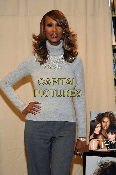 "IMAN.Signs copies of her new book, ""The Beauty Of Color"" at the Barnes & Noble Bookstore on 5th Avenue in Manhattan, New York, New York. .October 17th, 2005.Photo Credit: Patti Ouderkirk/AdMedia/Capital Pictures.Ref: PO/ADM.half length grey gray sweater turtleneck polo neck.www.capitalpictures.com.sales@capitalpictures.com.© Capital Pictures."