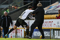 Alex Penny of Peterborough United pushing Bradford City manager Stuart McCall during the Sky Bet League 1 match between Bradford City and Peterborough at the Northern Commercial Stadium, Bradford, England on 26 December 2017. Photo by Thomas Gadd.