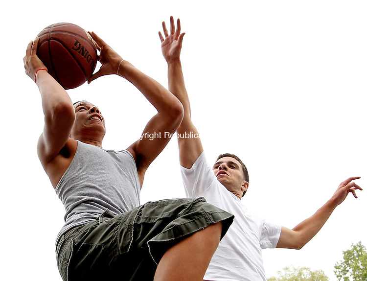 Naugatuck, CT-12, July 2010-071210CM02  Justin Setlock, 17, of Redding, PA goes up for a layup against Ruben Ferreira, 16 of Naugatuck during a one on one basketball game at Linden Park in Naugatuck Monday afternoon.  The two friends were enjoying the warmer weather that has struck the region in recent days.    --Christopher Massa Republican-American