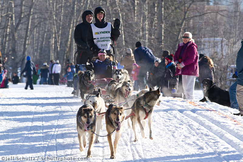 xxxxxxxxxx  and team run past spectators on the bike/ski trail during the Anchorage ceremonial start during the 2013 Iditarod race.    Photo by Britt Coon/IditarodPhotos.com